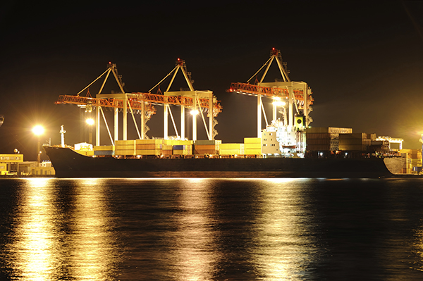 Cargo container ship at night